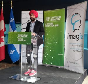 Minister Bains making the announcement